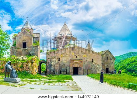 GOSH ARMENIA - MAY 31 2016: The churches and chapels of Goshavank Monastery located on the hill and surrounded by green mountains on May 31 in Gosh.