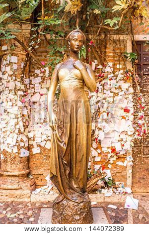 Verona, Italy - May 22, 2016: Juliet statue in Verona city. Romeo and Juliet is a tragedy written by William Shakespeare.
