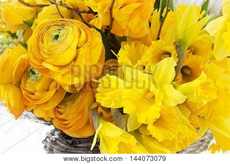 Yellow flowers bouquet in the basket celebration background