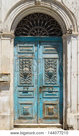 Blue Aged Tunisian Wooden Door With Arch And Ornament