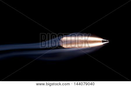 Copper plated bullet with polymer tip on the way to the target