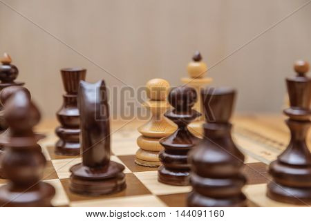 Pawn defends his king in chess game
