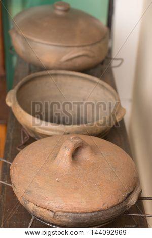 Rustic Ceramic Crock pot over a wooden table