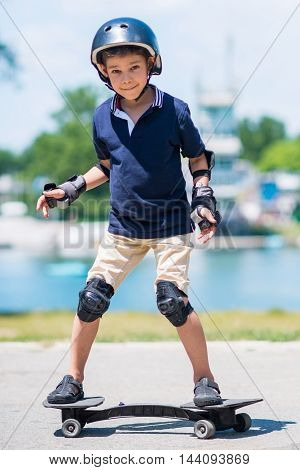 Snakeboard kid, toned image, vertical image, outdoors