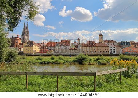 The picture was taken in Germany. The picture shows a beautiful view of the Danube coast in the ancient city of Regensburg.