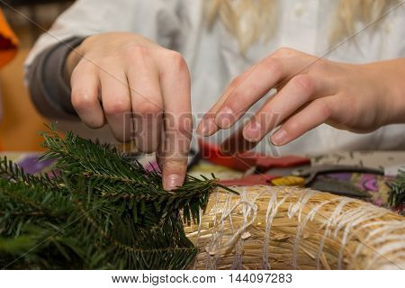 Person binds Advent wreath - close-up tradition