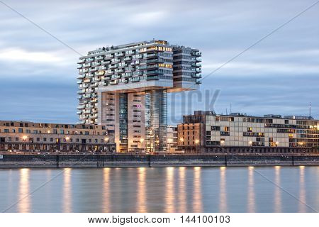 COLOGNE GERMANY - AUG 7 2016: Crane House at the Rhine river in Cologne illuminated at night. North Rhine-Westphalia Germany