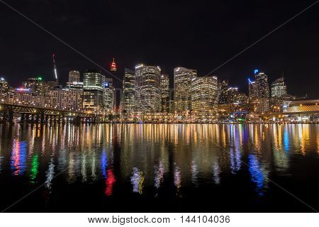 SYDNEY, AUSTRALIA - APRIL, 2016 : View of Sydney city skyline at night near Pyrmont Bridge, Cockle Bay Wharf in Sydney, Australia on April 19, 2016.