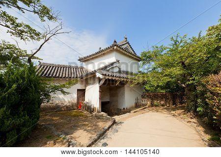 HIMEJI JAPAN - JULY 21 2016: Ni-no-mon (Second) Gate of Himeji castle (White Egret Castle circa 1609). Himeji-jo is National Treasure of Japan and UNESCO World Heritage Site