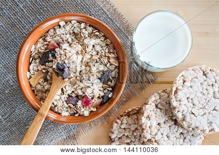 Serving Muesli Scattering Of Crispbread, Milk On Wooden Table