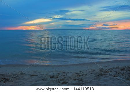 Beautiful beach Sunrise morning time before. Colorful sky and water in lake reflected. Select focus with shallow depth of field Soft focus noise and grain due long exposure.