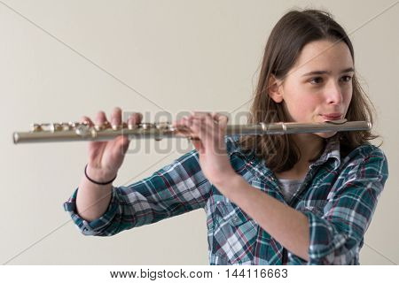 Teenagers playing flute - Portrait and Copy Space