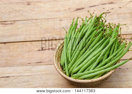 Fresh string bean  on  wooden  background for cooking