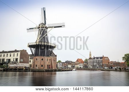 Haarlem By The Canal With Windmill, The Netherlands