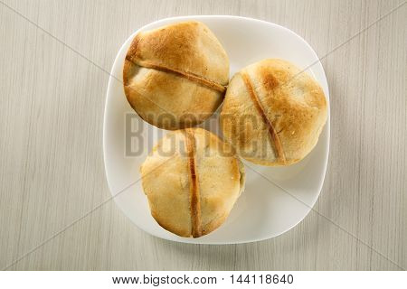 Empada Brazilian Snack. Pie With Chicken On White Plate On Wooden Background