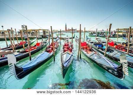 Venice, Italy - May 18, 2016: Gondoliers waiting for clients near San Marco square. Sailing in godolas is most popular tourist attraction in Venice