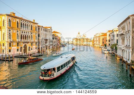Venice, Italy - May 18, 2016: View on Grand canal with vaporetto taxi swim full of people in Venice. Vaporetto is a popular water transport among residents and tourists in Venice
