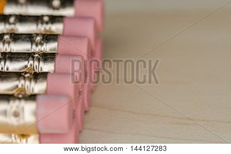 Close up image of many pencils on a desk