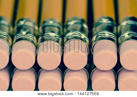 Image of many pencils on a desk close up