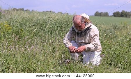 Beekeeper and smoker. Man with a smoker for bees