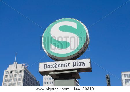 BERLIN GERMANY - AUGUST 25 2016: S-Bahn Urban Railway Station Sign Potsdamer Platz With Blurry Skyscrapers In The Background