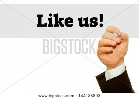 Businessman hand writing Like Us message on blue background.