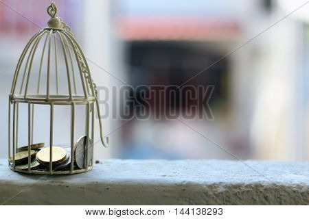 White cage with Malaysia Coin money inside with selective focus and blur background