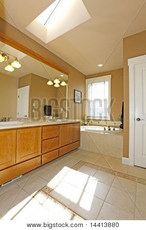 Vertical Bathroom With Tub And Warm Wood