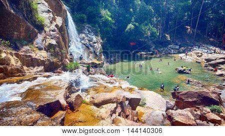 Scenery of Sungai Pandan Water Fall. Sungai Pandan Waterfall located 25 km from Kuantan town at Felda Panching Selatan Pahang. A slow shutter picture with soft water flow.