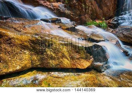 Scenery of Sungai Pandan Water Fall. Sungai Pandan Waterfall located 25 km from Kuantan town at Felda Panching Selatan Pahang. A slow shutter picture with soft water flow.