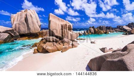 unique granite rocky beach Anse Marron in La Digue island, Seych