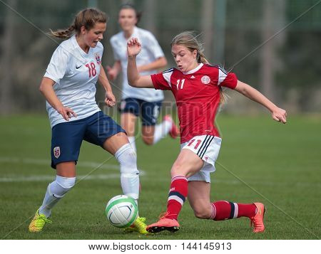 LINDABRUNN, AUSTRIA - APRIL 13, 2015: Andrea Norheim (#18 Norway) and Freja Kjaersig Sunesen (#11 Denmark) fight for the ball during a UEFA women's U17 qualifying game.