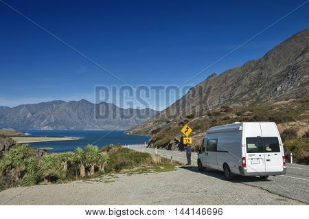 Otago New Zealand - February 2016 : Viewpoint at a rocky ridge called The Neck stands between Lake Wanaka and Lake Hawea at their closest point on the Makarora Lake Hawea road New Zealand