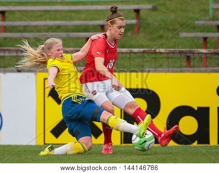 SANKT POELTEN, AUSTRIA - APRIL 13, 2015: Ida Stroemblad (#7 Sweden) and Laura Krumboeck (#18 Austria) fight for the ball during a UEFA women's U17 qualifying game.