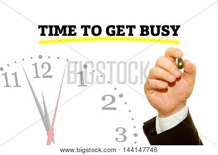 Businessman hand writing TIME TO GET BUSY message on a transparent wipe board.