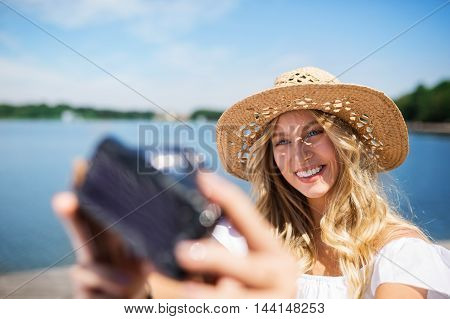 Girl Taking A Selfie At The Lake