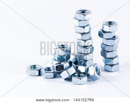 Bolts and screws on a white background. Bolts and screws used in construction. Tightening around the neck. Bolts and screws are descendants of mainly made of fine steel