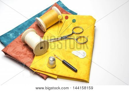 Thread spools, scissors and other sewing Utensils
