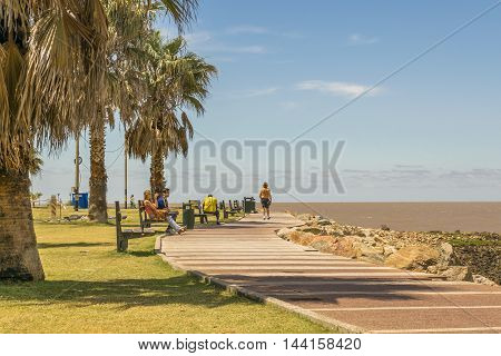 MONTEVIDEO, URUGUAY, - DECEMBER - 2015 - People enjoying a summer day at boardwalk in Pocitos neighborhood in Montevideo Uruguay