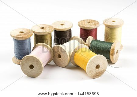 Wooden spools with threads in several colors