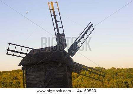 Old Wooden Windmill in Sunny Day Stock Photo