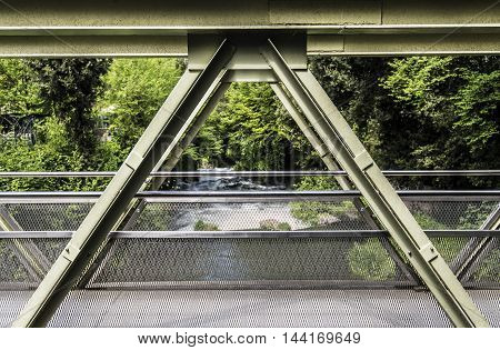 green small metallic bridge structure sunny day closeup