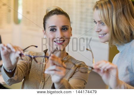 young woman Choosing glasses at the optician