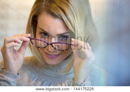 happy Young woman trying her beautiful glasses