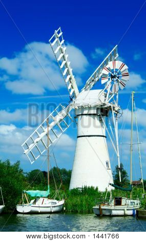 Windmill And Sailing Boats. Norfolk, England.