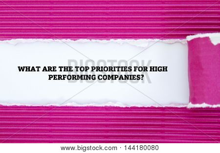 WHAT ARE THE TOP PRIORITIES FOR HIGH PERFORMING COMPANIES? question written under torn paper.