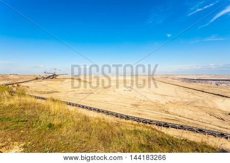 Open pit. Opencast brown coal mine. Belt conveyor as industrial detail.