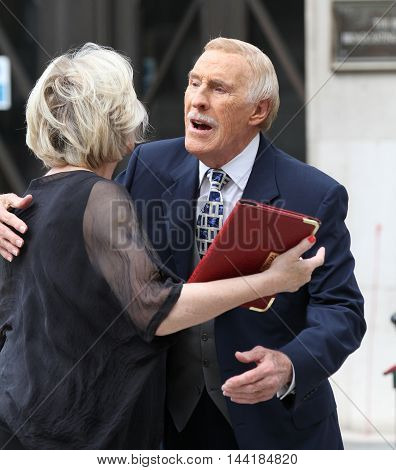 LONDON, UK, AUG 31, 2014: Bruce Forsyth seen leaving the BBC studios picture taken from the street