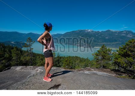 A girl takes a pause to take in a view on a hike