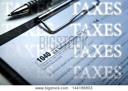 office work and filling in tax form with inscriptions taxes close up